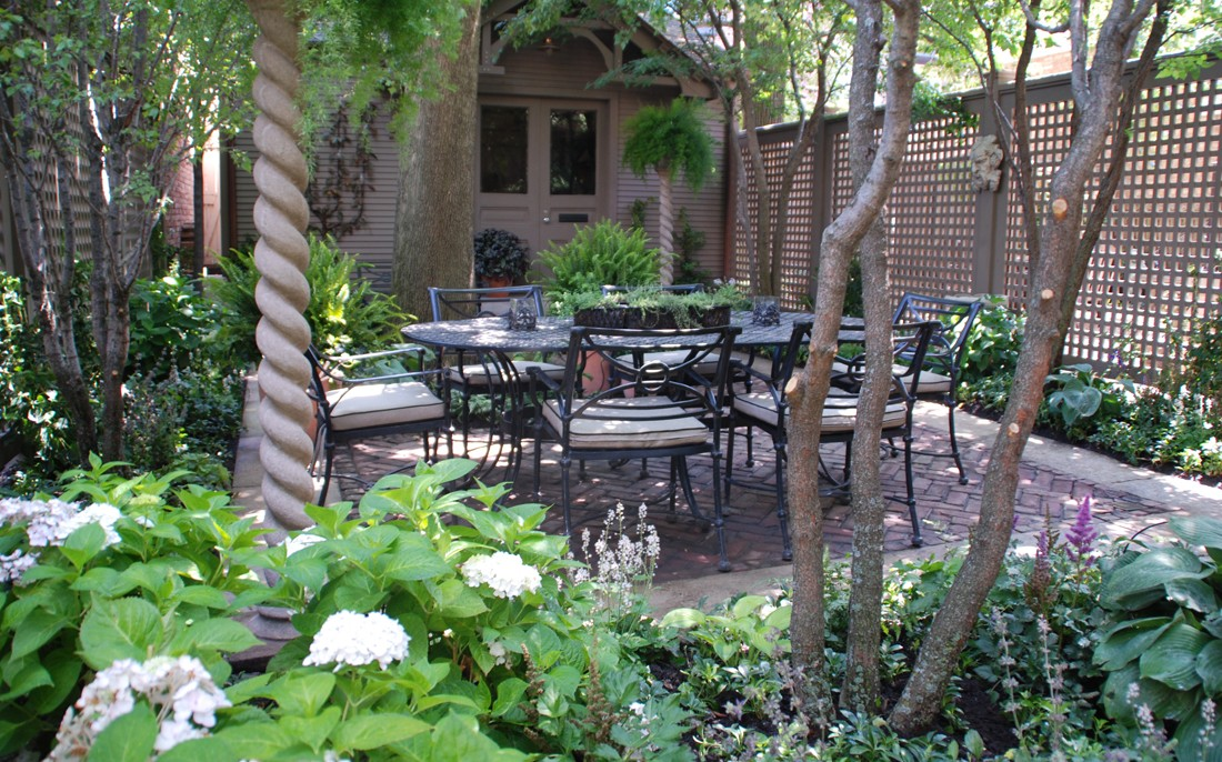 urban shade garden with outdoor dining table